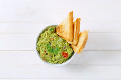 Bowl of guacamole with toasts Stock Photos