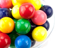 Bowl of gumballs. Bowl full of bright, colorful gumballs on white stock photos
