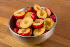 Bowl of halfed plums Royalty Free Stock Image