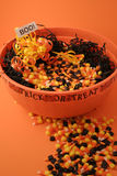 Bowl of Halloween Candy. Halloween arrangement featureing a large bowl of candy corn nestled in black raffia with a boo sign stock images