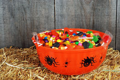Bowl of halloween candy on straw. Closeup bowl of halloween candy on straw stock photos