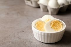 Bowl with hard boiled eggs on table. Space for text royalty free stock photos