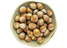 Bowl of hazelnuts Stock Images