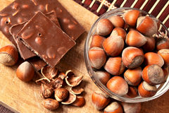 Bowl of hazelnuts and chocolate Royalty Free Stock Images