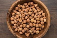 Bowl of hazelnuts stock photo