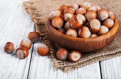 Bowl with hazelnuts Stock Photos