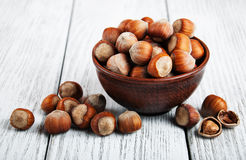 Bowl with hazelnuts. On a old wooden table Royalty Free Stock Images