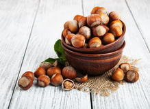 Bowl with hazelnuts. On a old wooden table Royalty Free Stock Photography