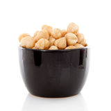 Bowl with hazelnuts Stock Photography