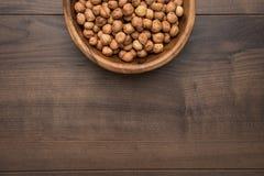 Bowl of hazelnuts stock image