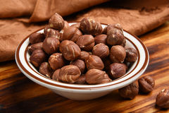 Bowl of hazelnuts Stock Images