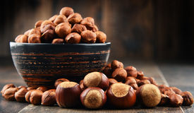 Bowl with hazelnuts on wooden table. Royalty Free Stock Photography