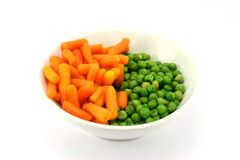 Bowl of health. Carrots and green peas in a bowl Stock Image