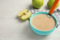 Bowl of healthy baby food. On light table Stock Images