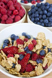 Bowl of Healthy Breakfast Cereals & Fruit Berries. A bowl of healthy breakfast cereals served with strawberries, raspberries and blueberries bowls of which Stock Photo