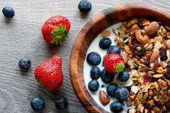 Bowl of healthy breakfast: granola with yogurt and fresh berries stock photos