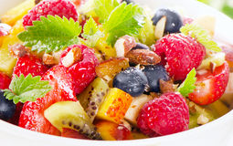 Bowl of  healthy fresh fruit salad with honey. Stock Image