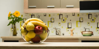 Bowl with healthy fruits in kitchen Royalty Free Stock Photos