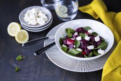 Roasted beetroot salad with feta and spinach. A bowl of healthy homemade roasted beetroot salad with feta and spinach royalty free stock images