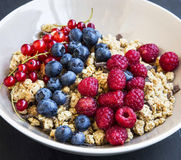 Bowl of healthy muesli with fresh berries stock images
