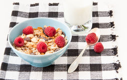 Bowl of healthy muesli with fresh raspberries. Bowl of healthy muesli  with fresh raspberries  and a glass of milk. selective focus Royalty Free Stock Photography