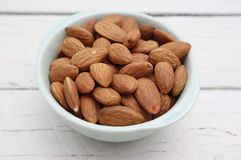 Bowl of Almonds on White Background stock images