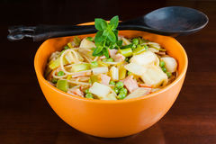 Bowl of healthy pasta with spring vegetables and bacon Royalty Free Stock Photography
