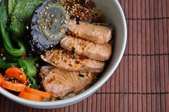 A bowl of healthy salmon and oriental salad Japanese food. A healthy salmon and oriental salad Japanese food with a black century Chinese egg Stock Images