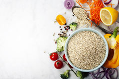 Bowl of healthy white quinoa seeds with vegetables Stock Photography