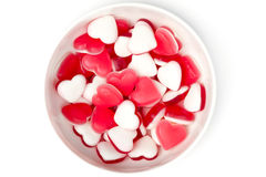 Bowl of Heart Shaped Sweets from Above. A top down shot of a white bowl full of heart shaped red and white sweets royalty free stock photo