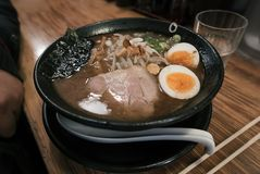Bowl of hearty ramen. A bowl of hearty ramen in local japanese restaurant stock image