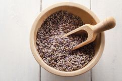 Bowl of Herbal Lavender Flower Buds with Scoop From Above stock photos