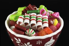 Bowl of Holiday Candy Black Background Stock Images