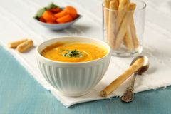 Bowl of homemade carrot soup with coconut milk and coriander Stock Photography