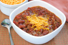 Bowl of Homemade Chili with Shredded Cheddar Stock Image