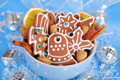 Bowl of homemade christmas gingerbread cookies on blue backgroun Stock Photos