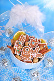 Bowl of homemade christmas gingerbread cookies on blue backgroun Royalty Free Stock Photo