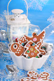 Bowl of homemade christmas gingerbread cookies on blue backgroun Stock Images