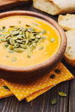 A bowl of homemade creamy pumpkin soup Stock Photography