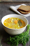 Bowl of homemade fish soup served with dark bread and dill Royalty Free Stock Photos