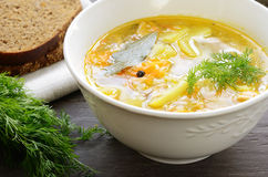 Bowl of homemade fish soup served with dark bread and dill Stock Images
