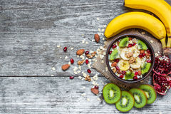 Bowl of homemade fruit oatmeal with fresh fruits Stock Images