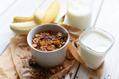A bowl of homemade granola, a glass of yogurt, fresh fruits and a bottle of milk Stock Photography