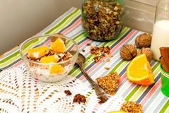 Bowl of homemade granola and oranges for breakfast Stock Photography