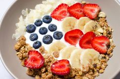 Bowl of homemade granola with yogurt and fresh berries in form of USA flag, Delicious Healthy Breakfast royalty free stock images