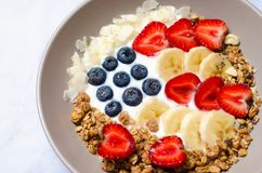 Bowl of homemade granola with yogurt and fresh berries in form of USA flag, Delicious Healthy Breakfast stock photos