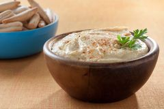 Bowl of homemade hummus with breadsticks Royalty Free Stock Photo