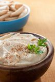 Bowl of homemade hummus with breadsticks Stock Photo