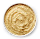 Bowl of homemade hummus. On white background from top view Stock Photography