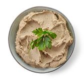 Homemade liver pate. Bowl of homemade liver pate isolated on white background, top view royalty free stock photos